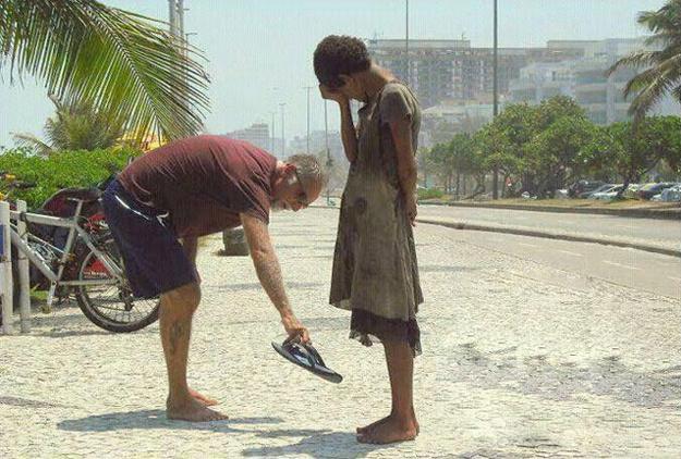 This photograph of a man giving his shoes to a homeless girl in Rio de Janeiro.