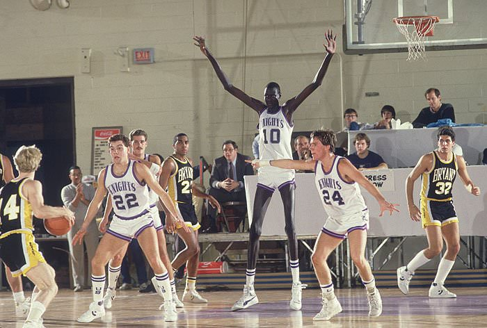 "In professional basketball, Manute Bol stood at 7'7"" (2.43 meters) tall and has a ""wingspan"" (arms outstretched) of 8'6"" (2.62 meters)."