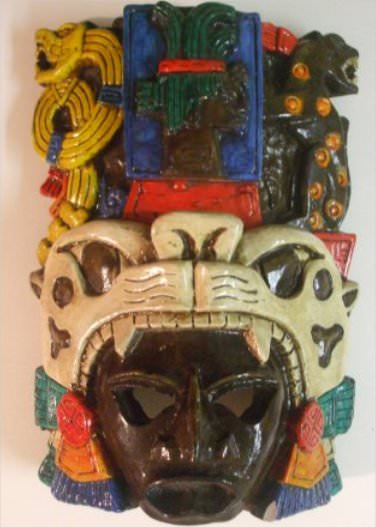 My souvenir from this trip. This is a Jaguar Mask that shows the jaguar at the bottom of the mask, a second jaguar at the top right hand side , the serpent at the top left and the last Mayan King, Pacal, in the top center of the mask.