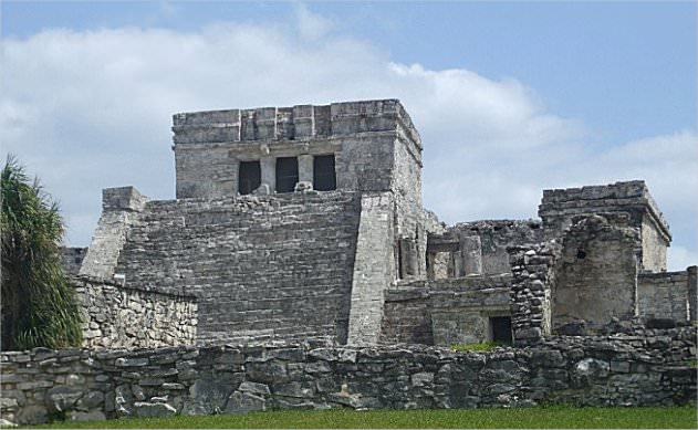 This is the Temple of Tulum. The steps leading to the top are very narrow and steep, forcing one to look down at their feet when climbing to the top, showing respect to the building and to Kukulkan (the plumed serpent).