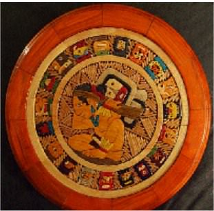 This is a hand-carved Mayan calendar, which is similar, but differs from the Aztec calendar.
