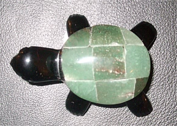 A turtle made from obsidian and jade.