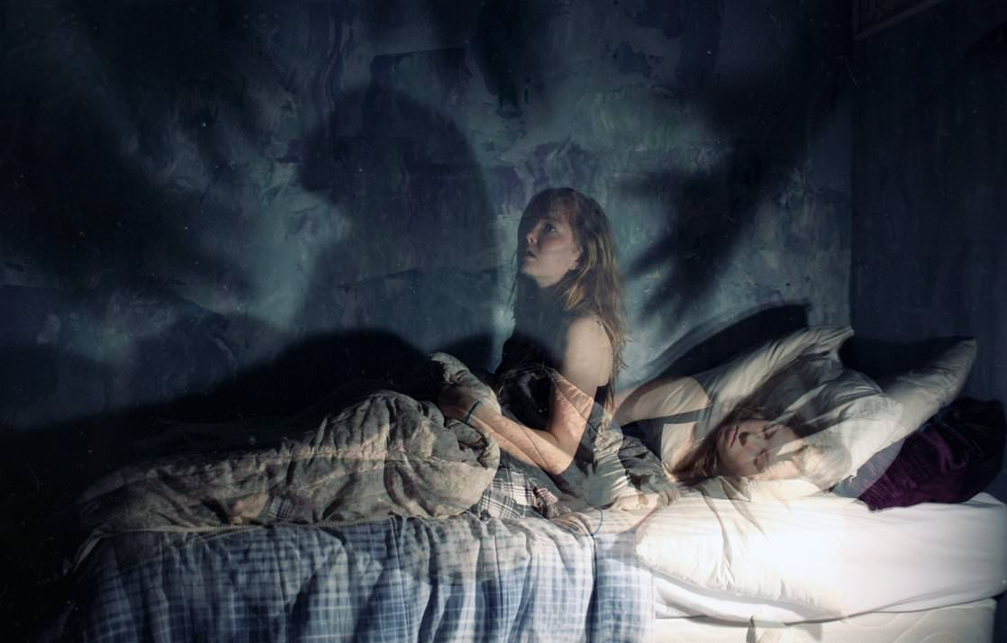 "The classic definition for this phenomenon is called sleep paralysis. It may last a few seconds, several moments, or occasionally longer and usually occurs right before you are about to fall asleep or wake up. Many people report feeling a ""presence"" that is often described as malevolent, threatening or, evil, and usually experience a tremendous amount of terror."