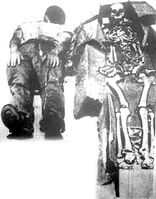 Figure 9: Les Eaton on the floor next to the 8-foot skeleton.