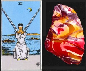 tarot card is the 2 of swords and the healing crystal will be Mookaite
