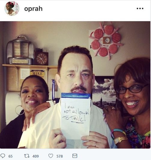 Oprah and Gayle King trying to protect Tom Hanks in this weird post they made. Nice hotdog clock too.